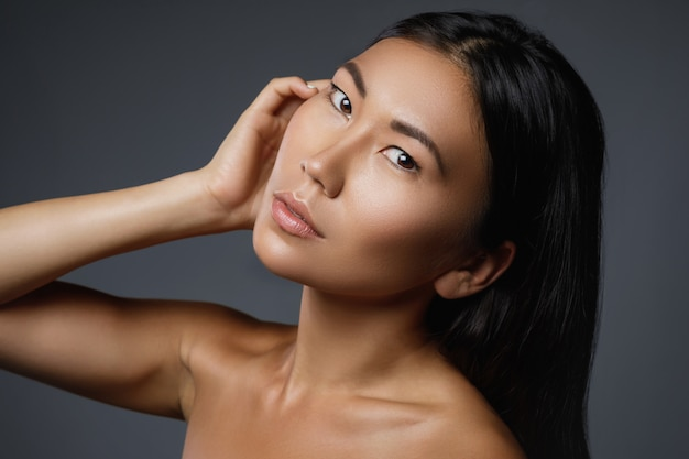 Beautiful asian woman with a black healthy hair