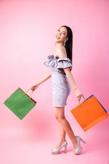 Beautiful asian woman with shopping bag