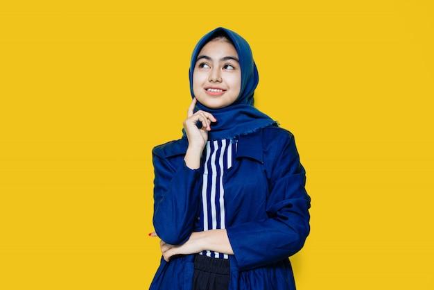 Beautiful asian woman on yellow wall