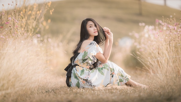Beautiful asian women girl sitting posing in the park flower picture style vintage