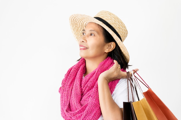 Beautiful asian women wearing straw hats and pink scarf happy and smiling,