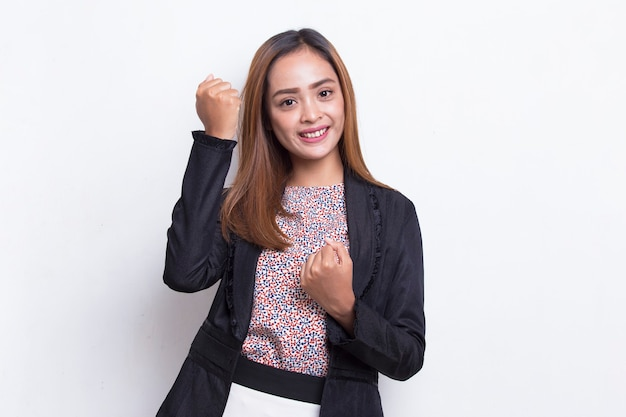 Beautiful asian young busisness woman happy and excited celebrating victory expressing big success