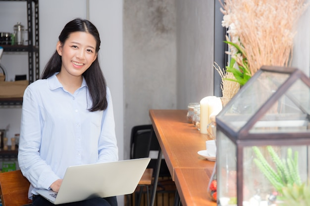 Beautiful asian young woman working online on laptop.