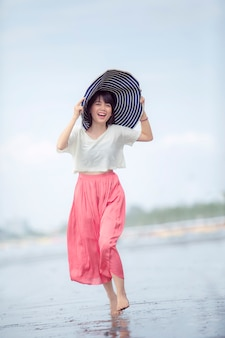 Beautiful asian younger woman happiness on vacation sea beach