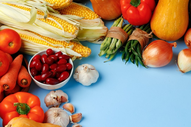 Beautiful assortment of colorful vegetables on blue background top view