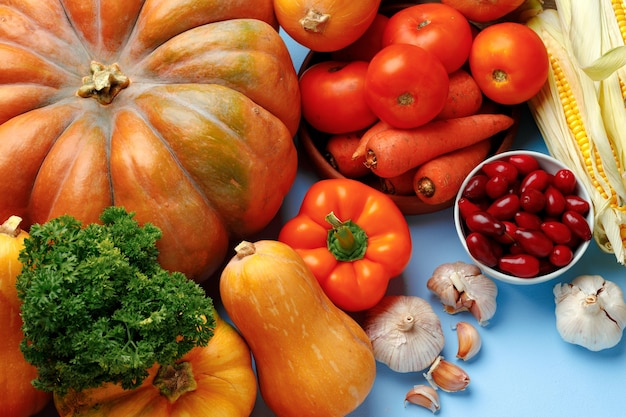Beautiful assortment of colorful vegetables on blue background