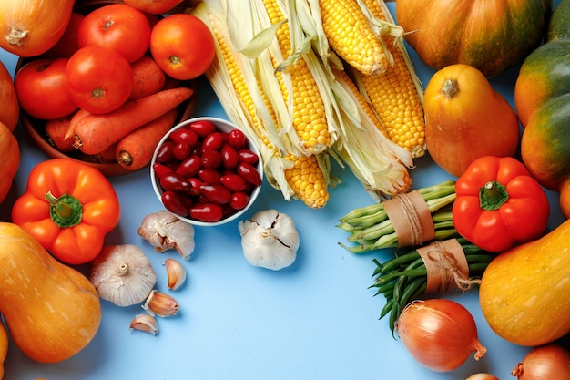 Beautiful assortment of colorful vegetables on blue
