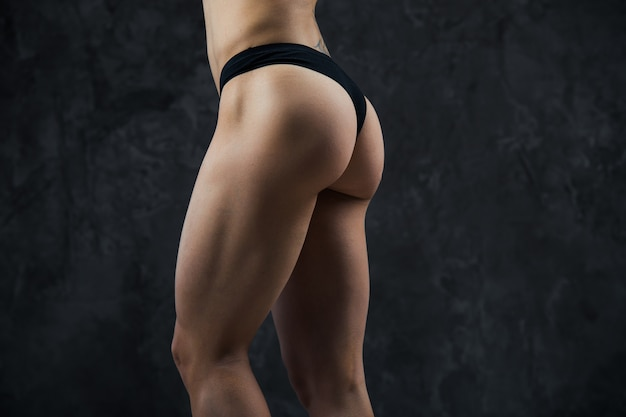Beautiful athletic ass close-up. perfect woman sexy buttocks in lingerie. clean healthy skin. part of body.