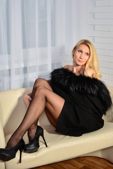 Beautiful attractive and sexy young adult sensuality pretty blonde woman in black
