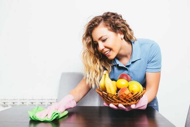 Beautiful attractive young woman preparing healthy vegetable meal