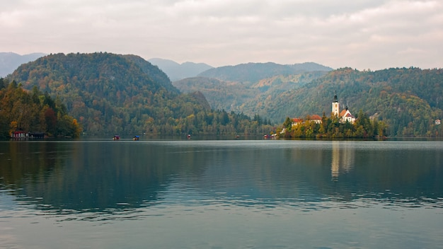 Beautiful autumn landscape around lake bled island with church a