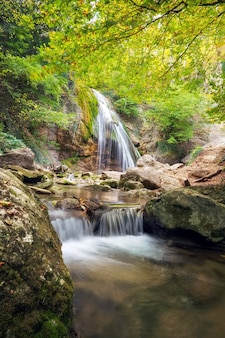 Beautiful autumn landscape with waterfall. composition of nature