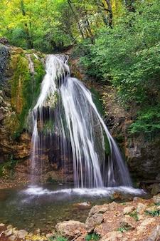Beautiful autumn landscape with waterfall