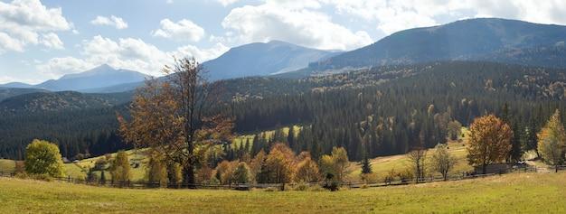 Beautiful autumn morning near carpathian village outskirts (in counter light). seven shots stitch image.