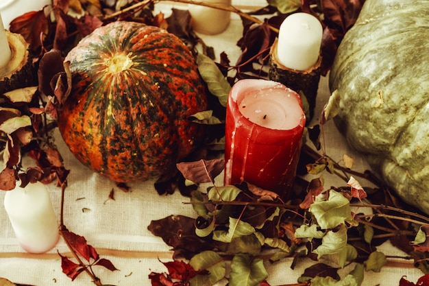 Beautiful autumn table decor with green pumpkin