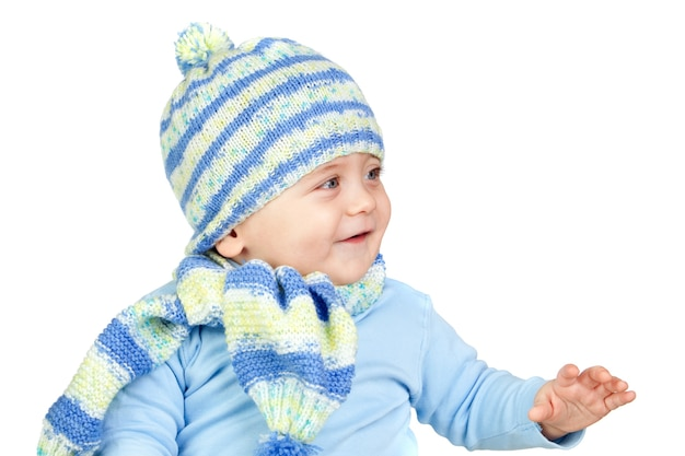 Beautiful baby warm with hat and scarf isolated