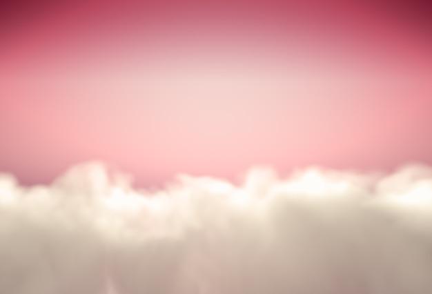 ピンクの空にふわふわの雲と美しい背景