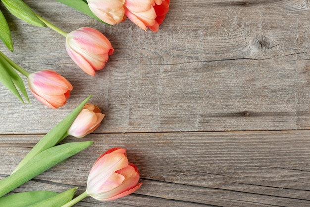 Beautiful background with spring flowers on old wooden. spring concept.