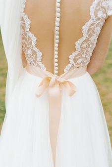 Beautiful backless wedding bridesmaid dress with lots of buttons and beige bow
