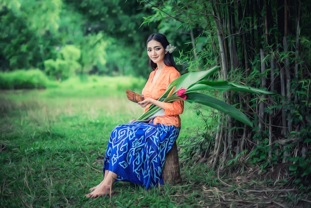 Beautiful balinese women in traditional costumes, culture of bali island and indonesia
