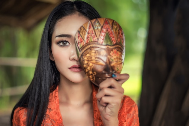 Beautiful balinese women in traditional costumes, with mask culture of bali island and indonesia
