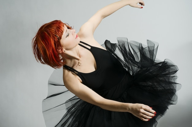 Beautiful ballerina wearing black tutu