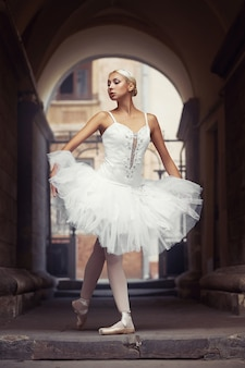 Beautiful ballet woman outdoors