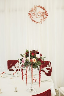 Beautiful banquet hall under a tent for a wedding reception.