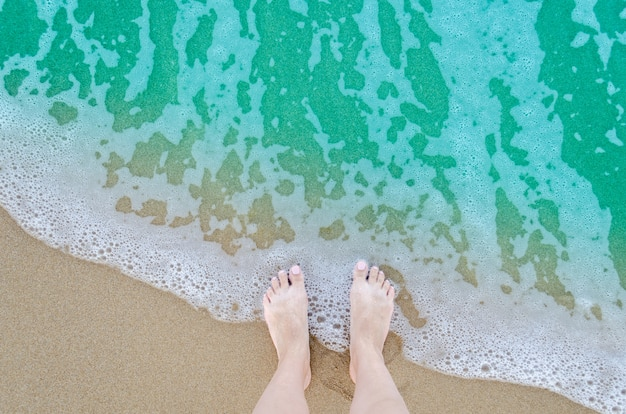 Beautiful bare feet on the beach