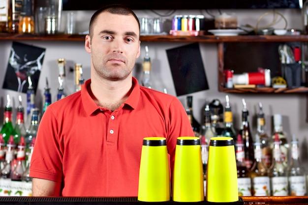 Beautiful barmen in red polo