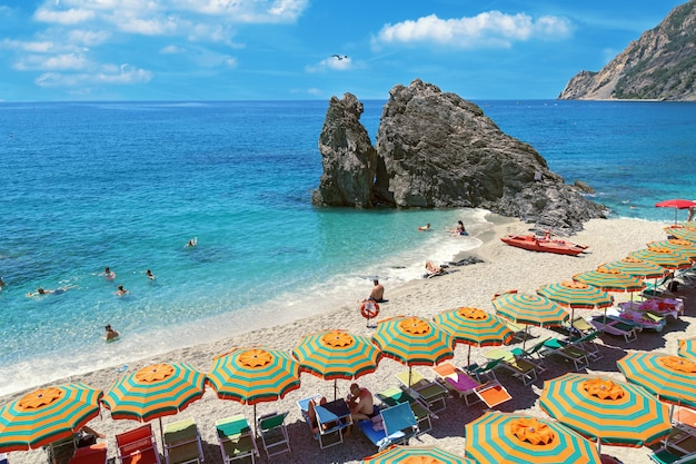 Beautiful beach popular tourist small town of monterosso in the cinque terre park in italy.