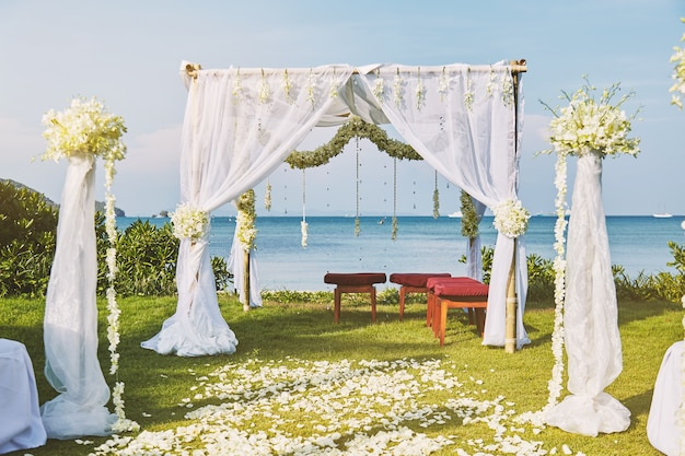 Beautiful beach wedding flower arch setting for wedding venue with panoramic ocean view