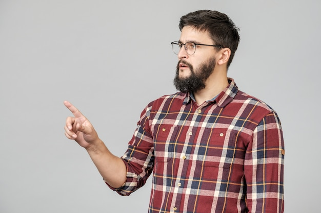 Beautiful bearded guy pointing aside