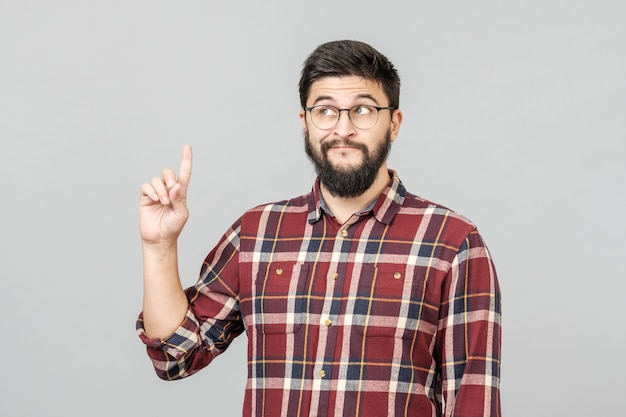 Beautiful bearded guy pointing up
