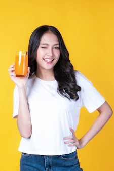 Beautiful beauty asian woman  cute girl feel happy drinking orange juice for good health on  white background - lifestyle beauty woman healthy concept