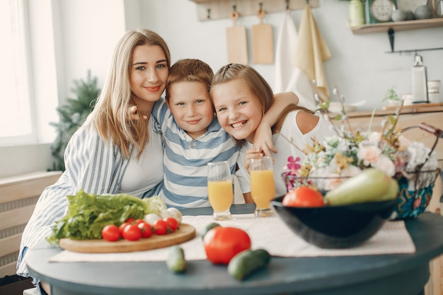 Beautiful big family prepare food in a kitchen