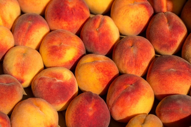 Beautiful big red peaches in a drawer.
