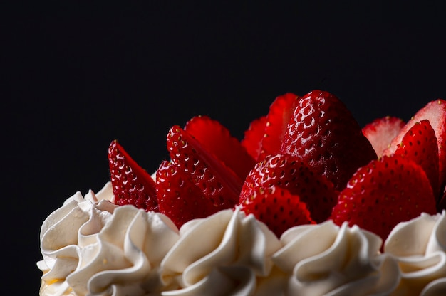 Beautiful birthday cake covered with chantillly and fresh strawberry. grey background. copy space. selective focus