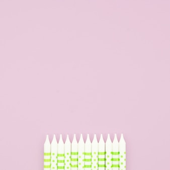 Beautiful birthday candles on pink background