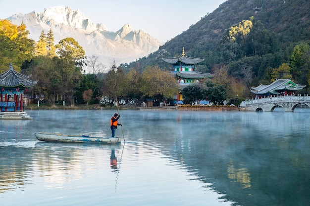 Beautiful of black dragon pool with jade dragon snow mountain , landmark and popular spot for tourists attractions near lijiang old town. lijiang, yunnan, china