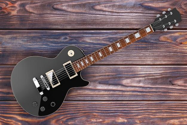 나무 테이블에 복고 스타일의 아름 다운 블랙 일렉트릭 기타. 3d 렌더링