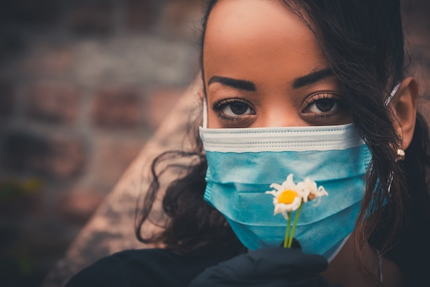 Beautiful black girl outdoor with a medical mask