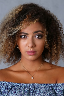 Beautiful black woman portrait. worth a gray