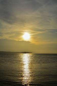 Beautiful blazing sunset landscape at sea, amazing summer sunset view on the beach, tropical thailand island.