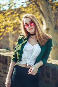 Beautiful blond caucasian woman faced to the Sun.