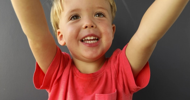 Beautiful blond child smiling asking for hold