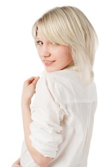 Beautiful blond teenage girl on white