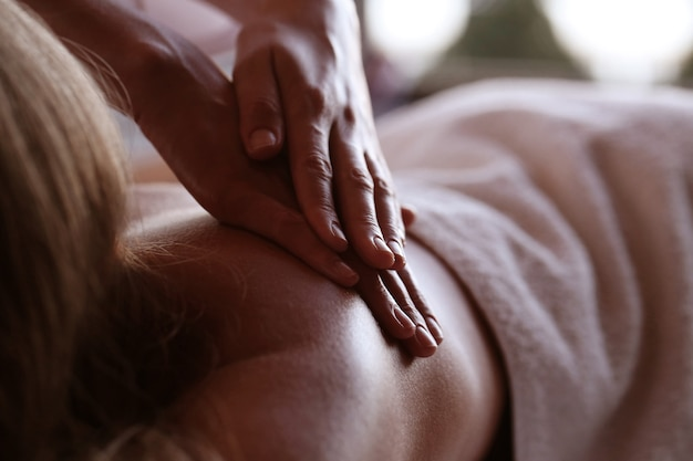 Beautiful blond woman receiving a massage