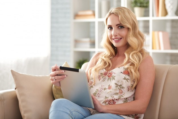 Beautiful blond woman using digital tablet