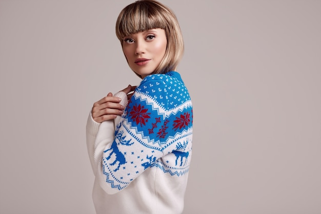 Beautiful blond woman with short hair in christmas sweater